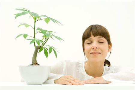 silk floss tree - Woman relaxing next to potted plant Stock Photo - Premium Royalty-Free, Code: 633-02345899