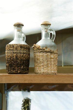 Glass bottles on shelf Stock Photo - Premium Royalty-Free, Code: 633-02645228