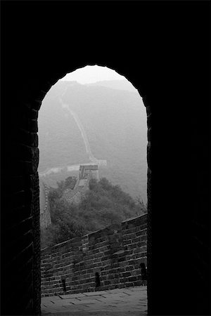 Looking out from arched doorway of room perched atop Great Wall of China Stock Photo - Premium Royalty-Free, Code: 633-02645306
