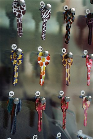 Rows of painted sample keys hanging on locksmith's rack Stock Photo - Premium Royalty-Free, Code: 633-02645333