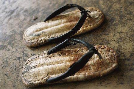 Pair of straw sandals Stock Photo - Premium Royalty-Free, Code: 633-02885698