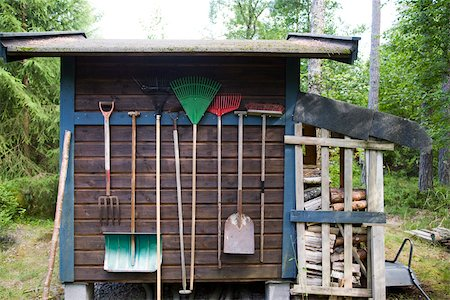 Gardening tools hung on side of shed Stock Photo - Premium Royalty-Free, Code: 633-03444801