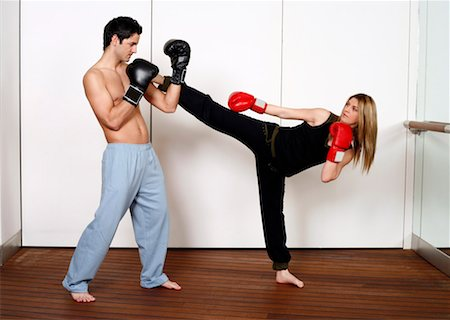 student fighting - Straight right-hand punch of Active Tae Bo and side kick Stock Photo - Premium Royalty-Free, Code: 644-01436494