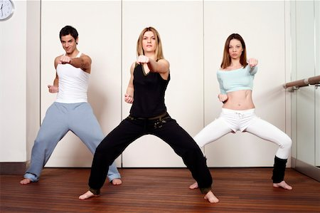 student fighting - Students in an Active Tae Bo class Stock Photo - Premium Royalty-Free, Code: 644-01436495