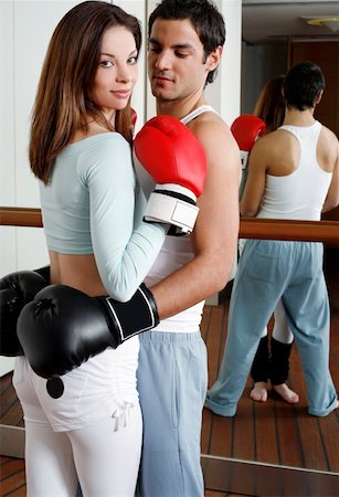student fighting - Young man and woman embracing in kickboxing class Stock Photo - Premium Royalty-Free, Code: 644-01436500