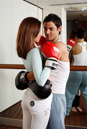 student fighting - Young man and woman embracing in kickboxing class Stock Photo - Premium Royalty-Free, Code: 644-01436679