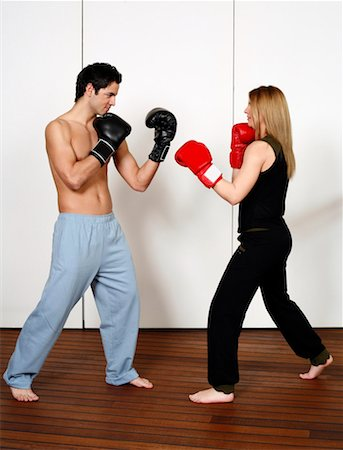 student fighting - Straight right-hand punch of Active Tae Bo and inside block Stock Photo - Premium Royalty-Free, Code: 644-01436935