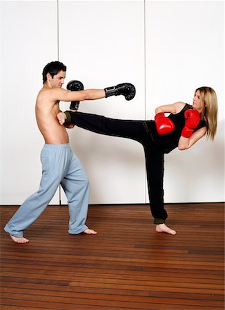 student fighting - Straight right-hand punch of Active Tae Bo and side kick Stock Photo - Premium Royalty-Free, Code: 644-01436939