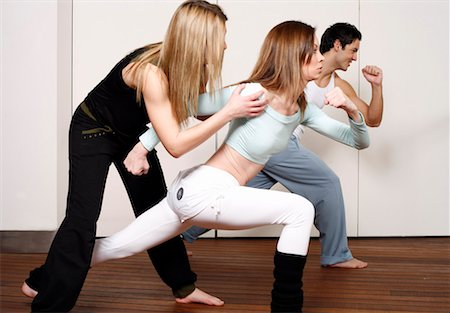 student fighting - Students learning a basic Capoeira move Stock Photo - Premium Royalty-Free, Code: 644-01436947