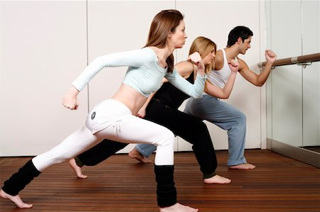 student fighting - Students learning a basic Capoeira move Stock Photo - Premium Royalty-Free, Code: 644-01436948