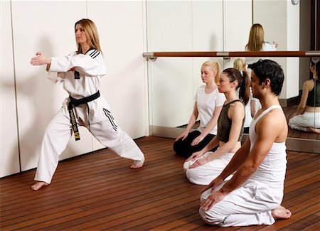 student fighting - Students observing Tae Kwon Do - Dantae demonstration Stock Photo - Premium Royalty-Free, Code: 644-01436961