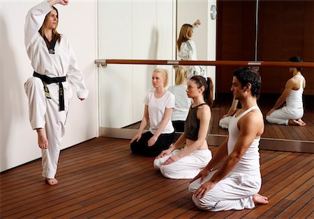 student fighting - Students observing Tae Kwon Do - Dantae demonstration Stock Photo - Premium Royalty-Free, Code: 644-01436963