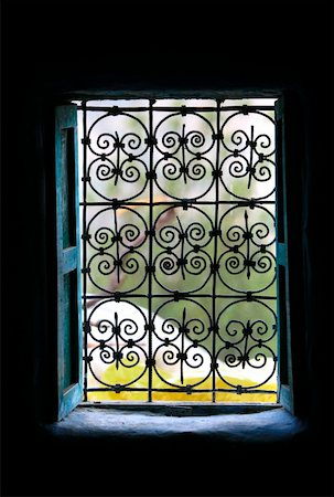 scroll (design) - Window with wrought ironwork Stock Photo - Premium Royalty-Free, Code: 644-01437412