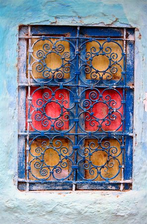 scroll (design) - Painted window with wrought ironwork Stock Photo - Premium Royalty-Free, Code: 644-01437413