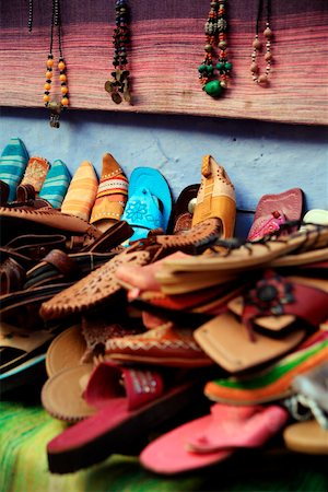 Moroccan slippers and necklaces for sale Stock Photo - Premium Royalty-Free, Code: 644-01437448