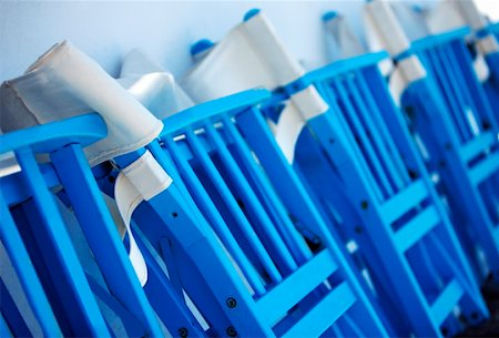 front row seat - Row of folded chairs Stock Photo - Premium Royalty-Free, Code: 644-01437846
