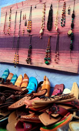 Moroccan slippers and necklaces for sale Stock Photo - Premium Royalty-Free, Code: 644-01437923