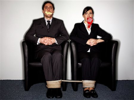 Male and female business people gagged and tied Stock Photo - Premium Royalty-Free, Code: 644-01630948