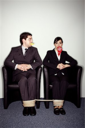 Male and female business people gagged and tied Stock Photo - Premium Royalty-Free, Code: 644-01630949