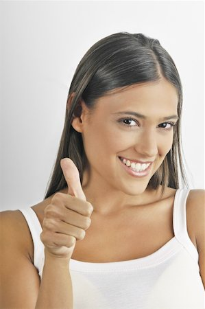 Female young adult;thumbs up Stock Photo - Premium Royalty-Free, Code: 644-02152735