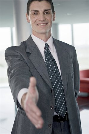 Businessman with hand out for handshake Stock Photo - Premium Royalty-Free, Code: 644-02922996