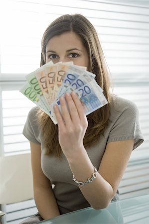 Professional woman holding euro bills Stock Photo - Premium Royalty-Free, Code: 644-02923011