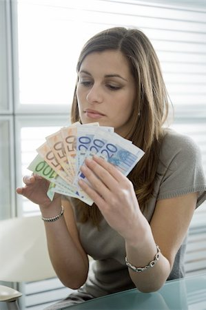 Professional woman counting euro bills Stock Photo - Premium Royalty-Free, Code: 644-02923012