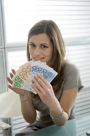 Professional woman holding euro bills Stock Photo - Premium Royalty-Free, Code: 644-02923013