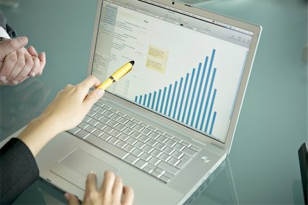 Business people's hands with laptop showing bar chart Stock Photo - Premium Royalty-Free, Code: 644-02923224