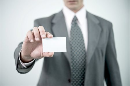 Businessman holding blank business card Stock Photo - Premium Royalty-Free, Code: 644-02923281