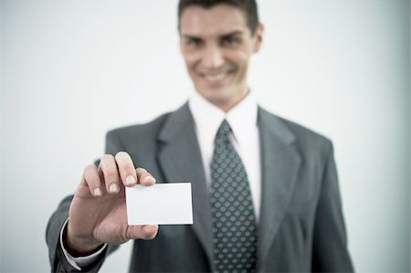 Businessman holding blank business card Stock Photo - Premium Royalty-Free, Code: 644-02923282