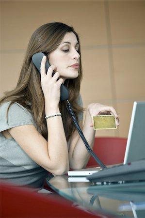 secretary desk - Businesswoman holding credit card at laptop Stock Photo - Premium Royalty-Free, Code: 644-02923296