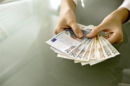 Woman's hands holding euro bills Stock Photo - Premium Royalty-Free, Code: 644-02923314