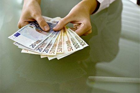Woman's hands holding euro bills Stock Photo - Premium Royalty-Free, Code: 644-02923315