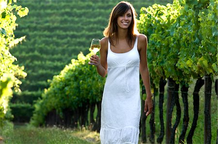 Young woman in vineyard holding wine glass Stock Photo - Premium Royalty-Free, Code: 644-03405475