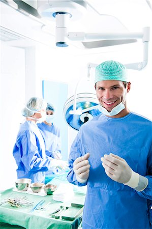 Medical personnel in operating room Stock Photo - Premium Royalty-Free, Code: 644-03659444