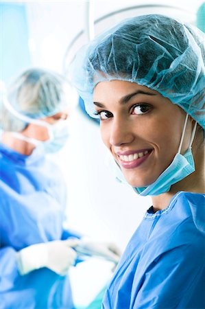Medical personnel in operating room Stock Photo - Premium Royalty-Free, Code: 644-03659474