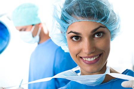 Medical personnel in operating room Stock Photo - Premium Royalty-Free, Code: 644-03659476