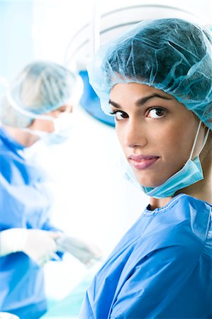 Medical personnel in operating room Stock Photo - Premium Royalty-Free, Code: 644-03659473