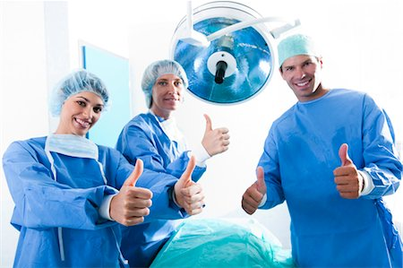 Medical personnel in operating room Stock Photo - Premium Royalty-Free, Code: 644-03659489