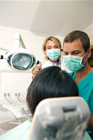 Dental professionals with patient Stock Photo - Premium Royalty-Free, Code: 644-03659557
