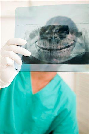 dentistry - Dentist holding dental panoramic xray Stock Photo - Premium Royalty-Free, Code: 644-03659551