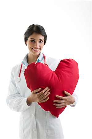 prevention - Doctor holding heart pillow Stock Photo - Premium Royalty-Free, Code: 644-03659607