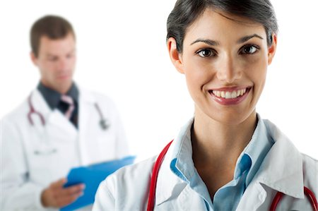 results - Doctor smiling and doctor reading medical chart Stock Photo - Premium Royalty-Free, Code: 644-03659629