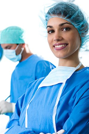 Medical personnel in operating room Stock Photo - Premium Royalty-Free, Code: 644-03672104