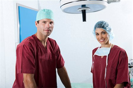 Medical personnel in operating room Stock Photo - Premium Royalty-Free, Code: 644-03672107