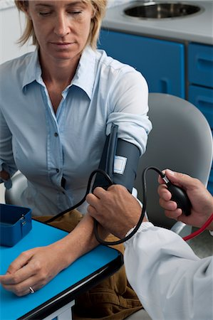pressure - Doctor taking patient's blood pressure Stock Photo - Premium Royalty-Free, Code: 644-03672116