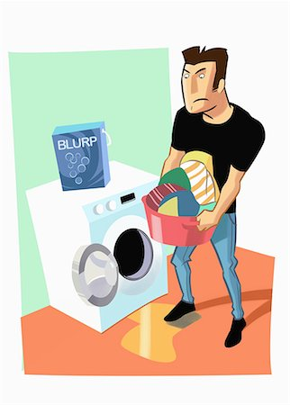 Man emptying washing machine of laundry Stock Photo - Premium Royalty-Free, Code: 645-01740296