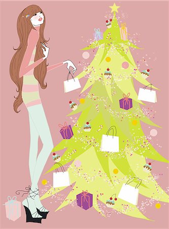 Young woman at Christmas tree with presents Stock Photo - Premium Royalty-Free, Code: 645-02925889