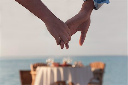 Couple holding hands Stock Photo - Premium Royalty-Free, Code: 649-04247566